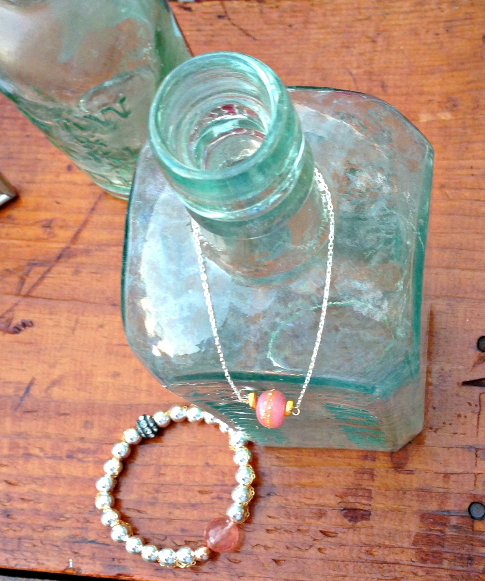 {Handmade with Sterling Silver chain, gold filled bead and a special handblown German glass bead that is accented with Fine silver. Bead is handmade in Maui, Hawaii.}