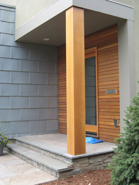 Entrance is lined with zinc panels