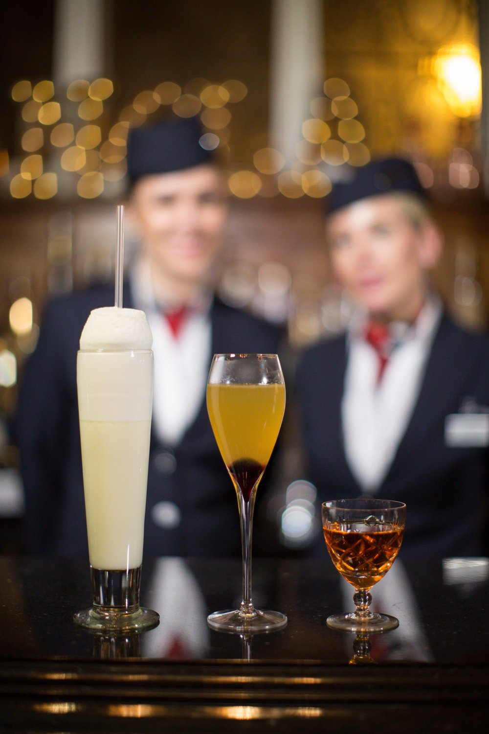 BA ambassadors Lisa and Emma with three of New Orleans' most famous cocktails, the Ramos Gin Fizz, the French 75 and the Sazerac at NOLA, London (C) Nick Morrish-British Airways-min.jpg