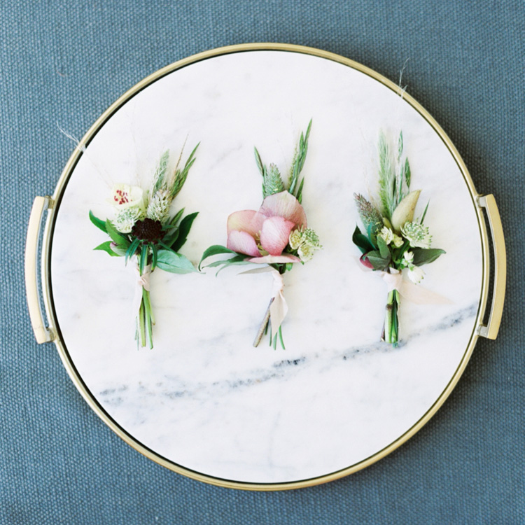 Boutonnieres of Hellebores and Grasses by Sprout Floral Design
