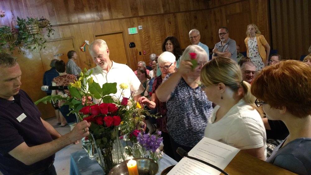 Congregants select a flower during the annual Flower Communion service on June 12, 2016.
