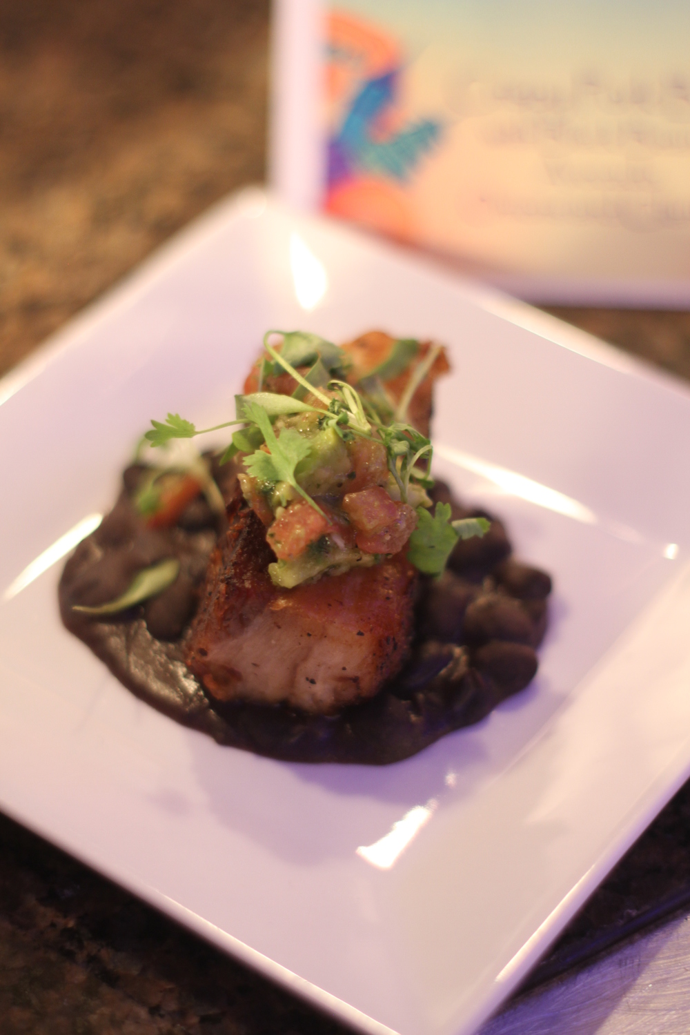 Crispy pork belly with black beans and avocado.