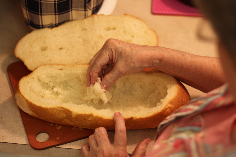 Hollowing the loaf of bread.