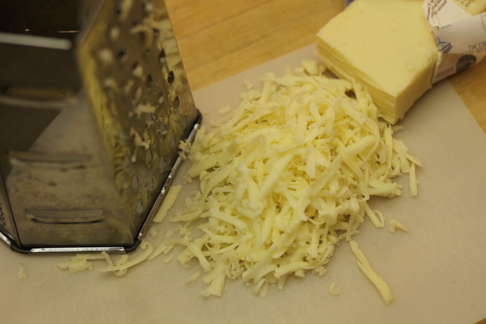 Shredded sharp cheddar cheese.