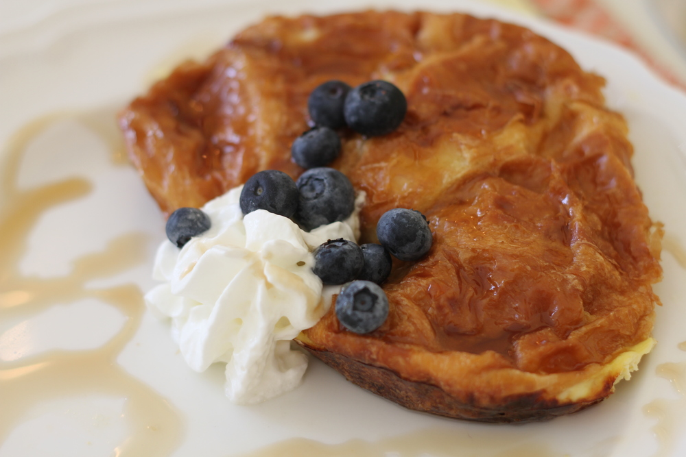 The highlight of breakfast - croissant stuffed with cream cheese and topped with blueberries and whipped cream