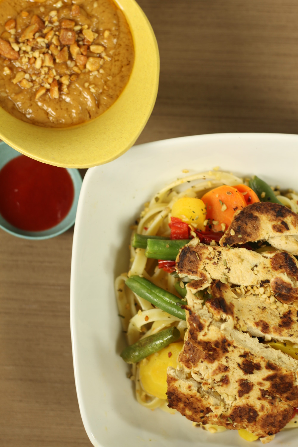 Spicy peanut sauce with noodles, vegetables, and baked chicken.