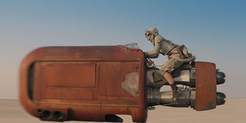 Rey scavenges Jakku for scraps of metal in Star Wars: The Force Awakens