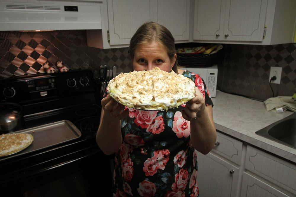 Christi holding her Grandmothers Peanut Butter Pie