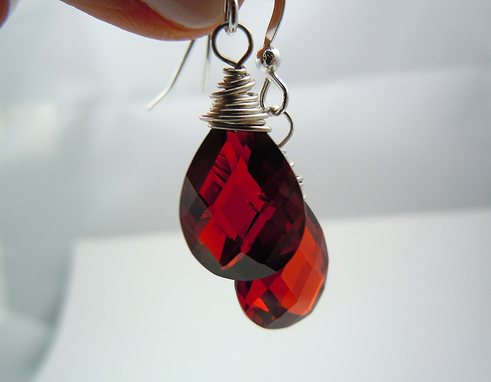 An elegant Cubic Zirconia garnet red sterling silver earring