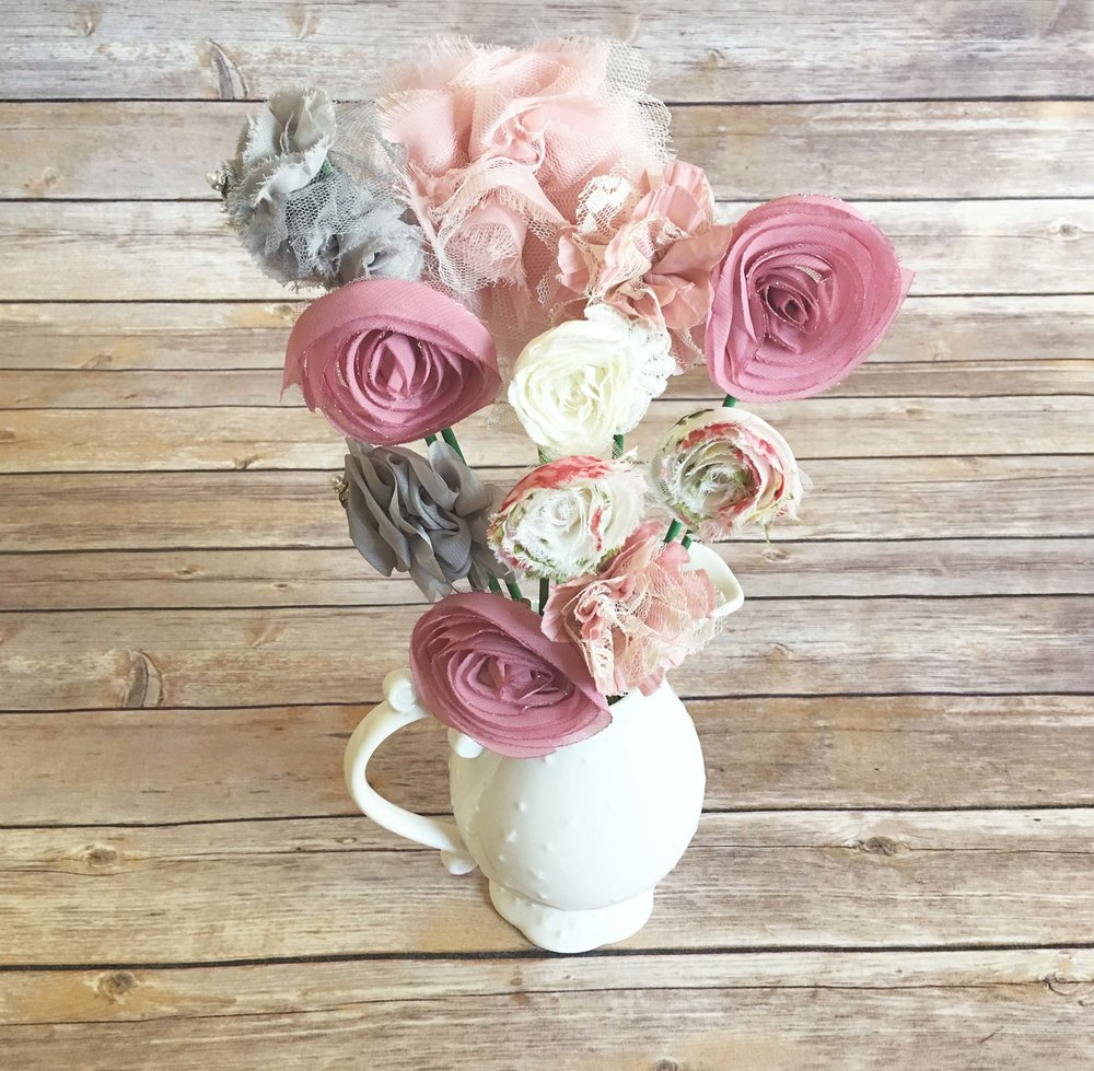 Bouquets cheekykakes made from similar ingredients to our kakes washcloths onesies socks beanies hand mitts hair bows headbands and more bouquets come in a variety of izmirmasajfo