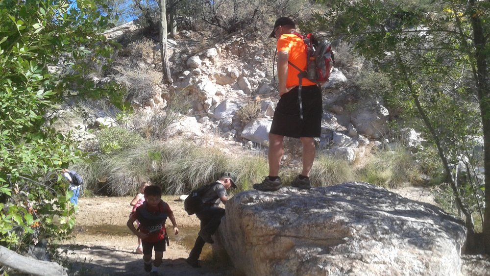 Catalina Pastor preaching from the rock.jpg