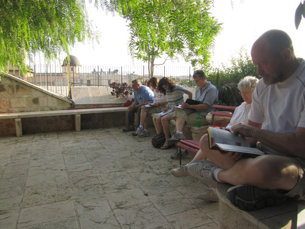 The group enjoying morning quiet time in the rooftop garden of the Lutheran Guesthouse