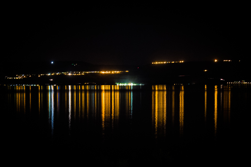 At night the lights of the cities that ring the Sea of Galilee are reflected in the waters of this amazing lake.