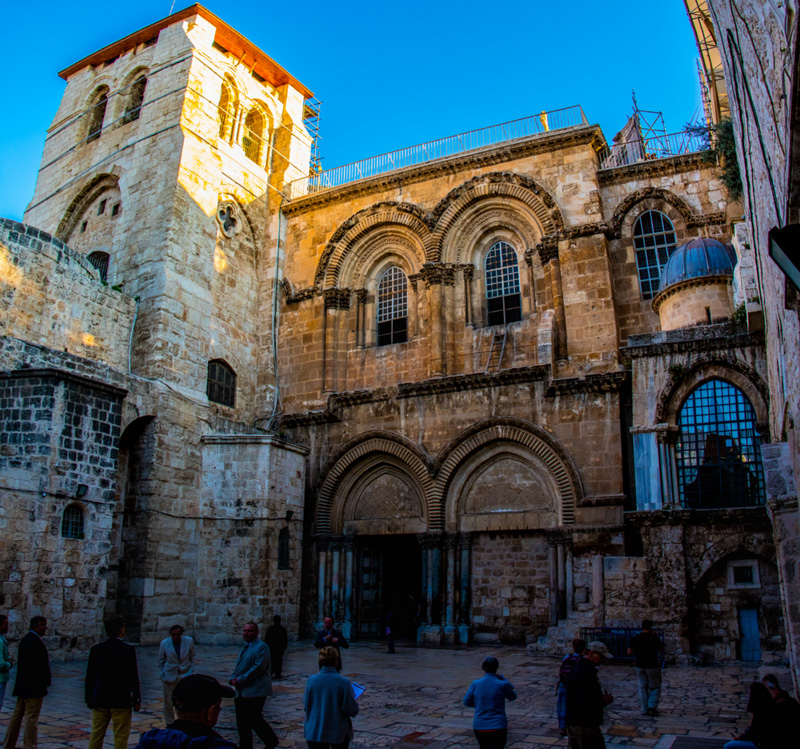 The battered facade of the ancient Church of the Holy Sepulcher, significant for what happened here rather than the beauty of its architecture.
