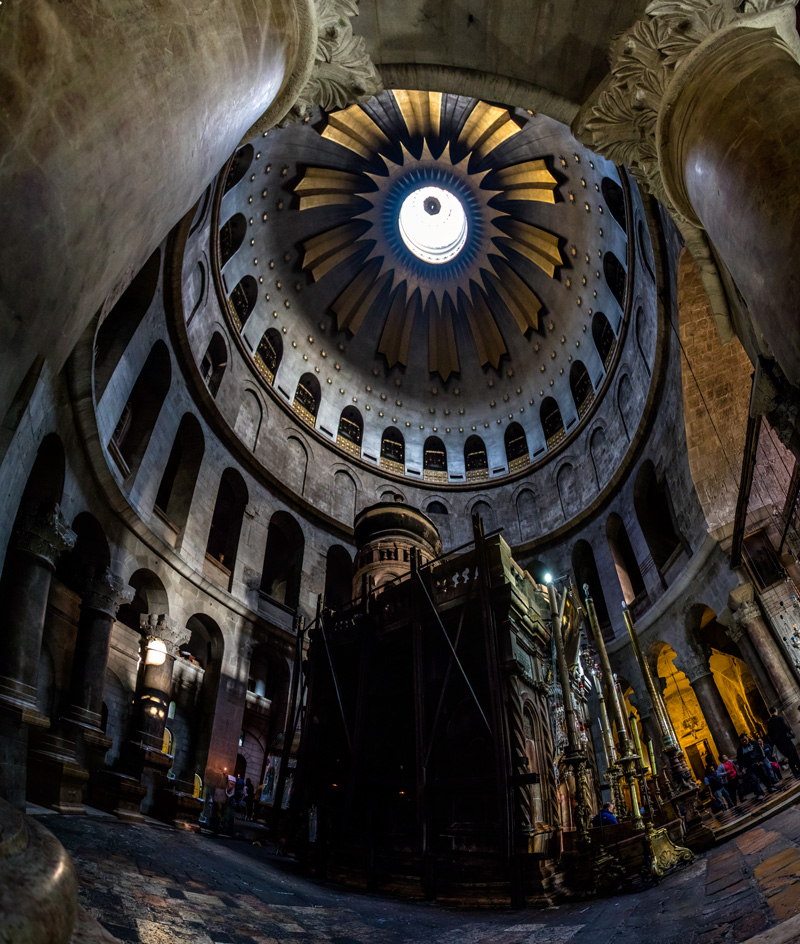 The rock-cut tomb of Jesus standing under the glorious dome of the resurrection.