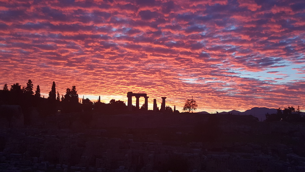 Sunset over the Temple of Apollos in ancient Corinth, Greece