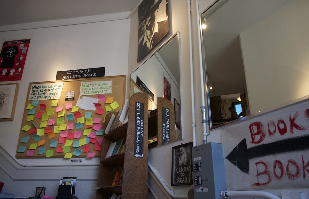 Upstairs to the Poety & Beat Literature room. Community Bulletin Board asks questions, customers answer with Post-Its.