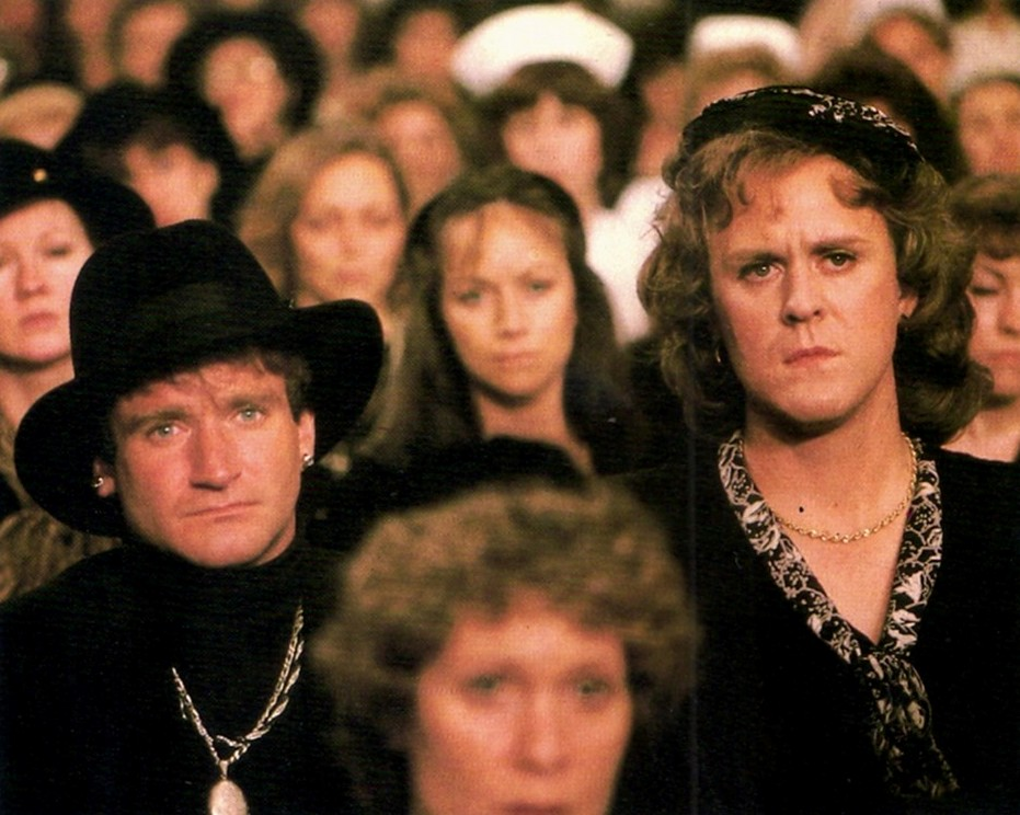 Robin Williams in drag, John Lithgow as a woman, in a memorial service closed to men in The World According to Garp