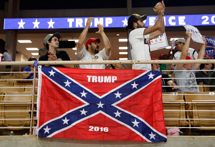 These Trump supporters, brandishing the Confederate battle flag which was created to signify the fight to keep black people as slaves, are not racist at all.