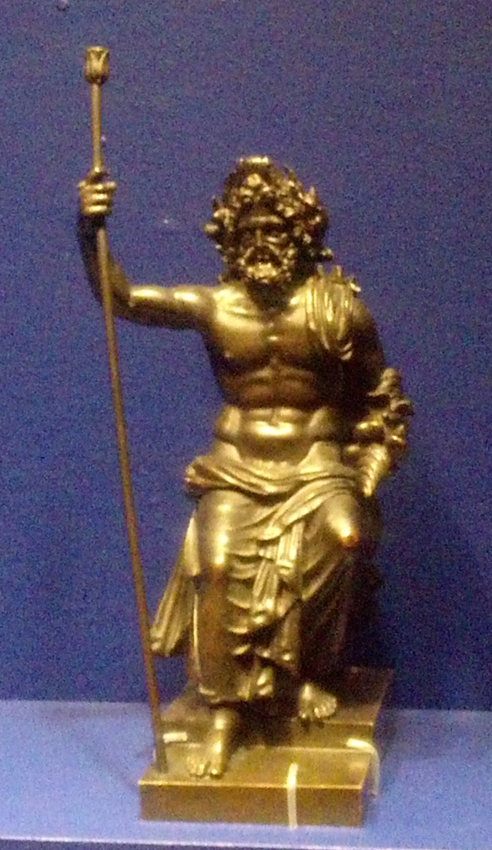 Bronze statuette in bronze, only a few inches high. 1st-2nd Century A.D. (or, okay, B.C.E.). Photo taken by me from a visiting exhibit at the Portland Art Museum. This pose imitates that of the 43-foot tall statue by Phidias in Zeus' temple in Olympia, one of the Seven Wonders of the Ancient World. This was only a few inches high.