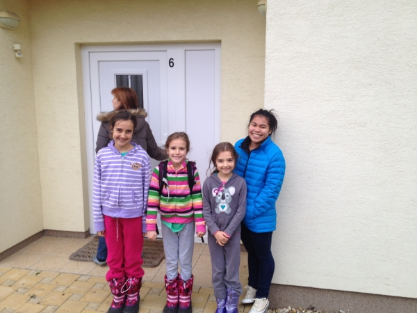 The girls waiting while our landlord unlocks the door.  It was an exciting moment for them!