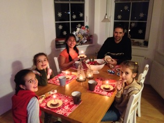 Our family getting ready to blow out the candles on our Happy Birthday, Jesus cupcakes on Christmas night.