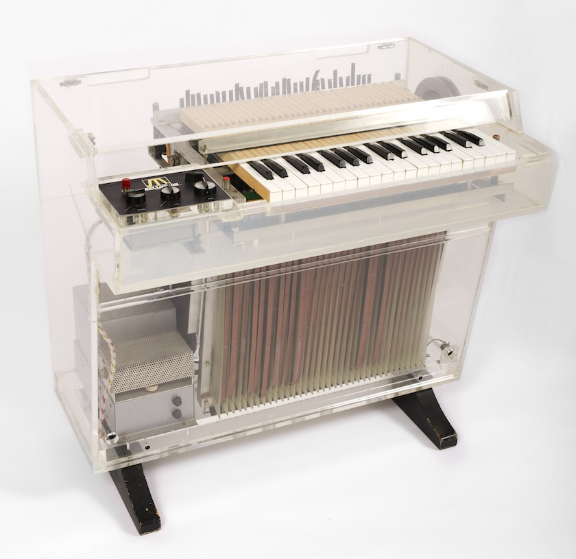 "Under the hood you can see the Mellotrons tape mechanism.  The Mellotron was famously used in the introduction of  ""Strawberry Fields Forever"" by The Beatles ."