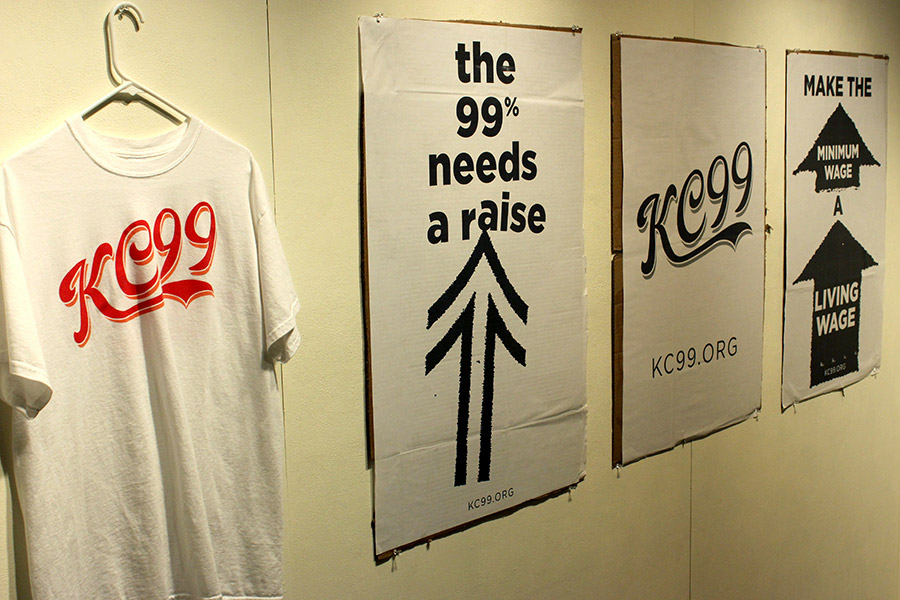 kc99 shirt and protest posters, in support of better pay for low-wage workers in k.c.