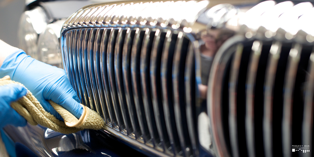 Polishing the traditional Daimler grille chrome slats.