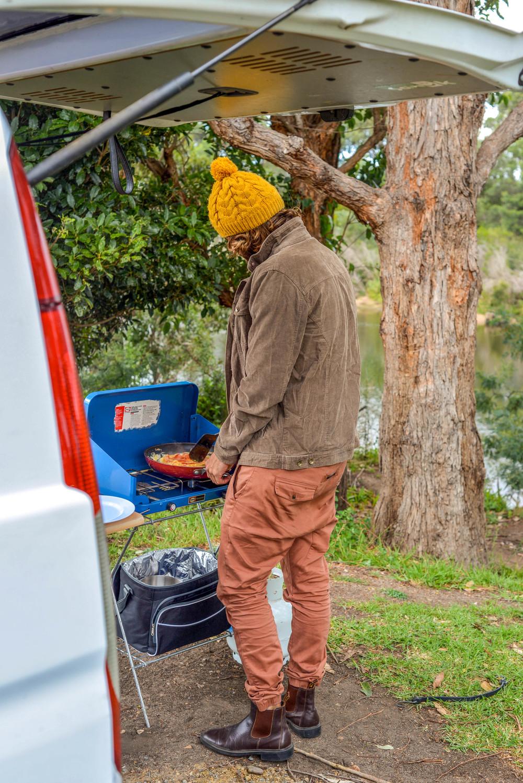 Jonny making breakfast in Snowy River, New South Wales.