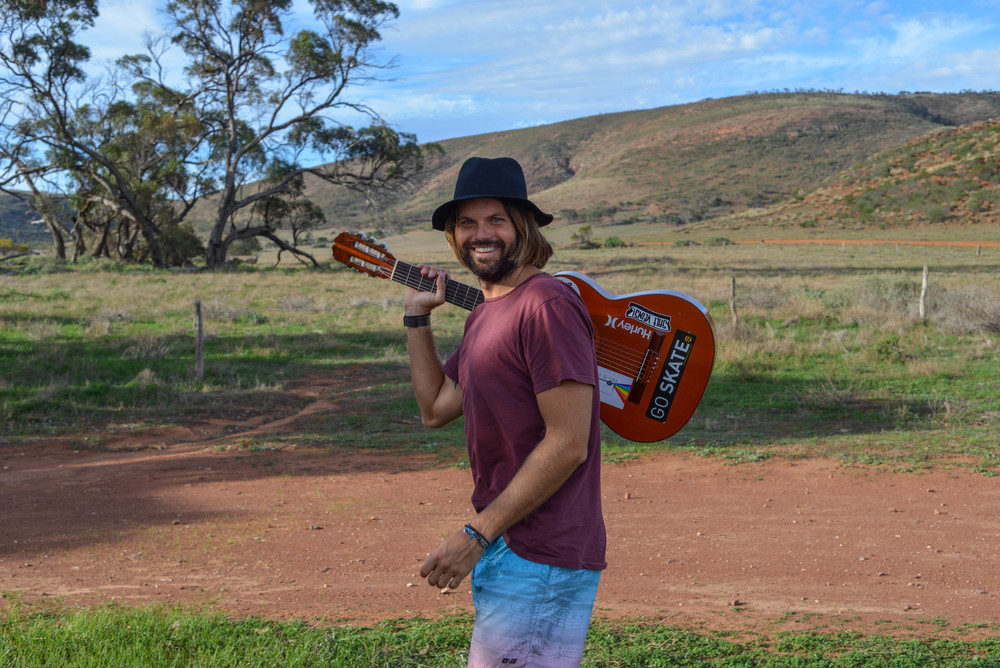 Jonny making music in the outback.