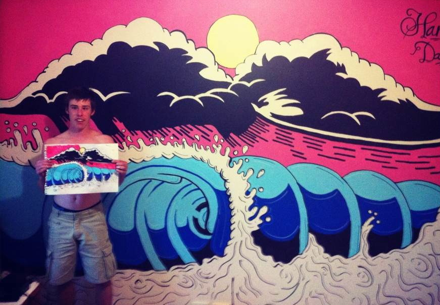 Harry infront of his wall art.
