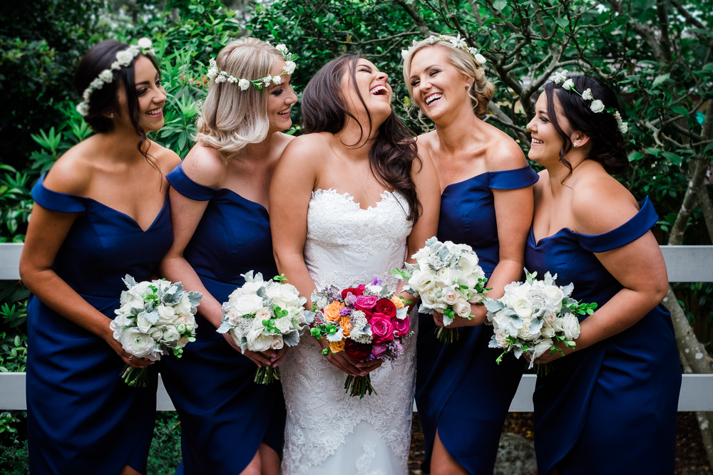 Yarra-Valley-Natural_Wedding_photography-Happy-bridesmaids-laughing.jpeg