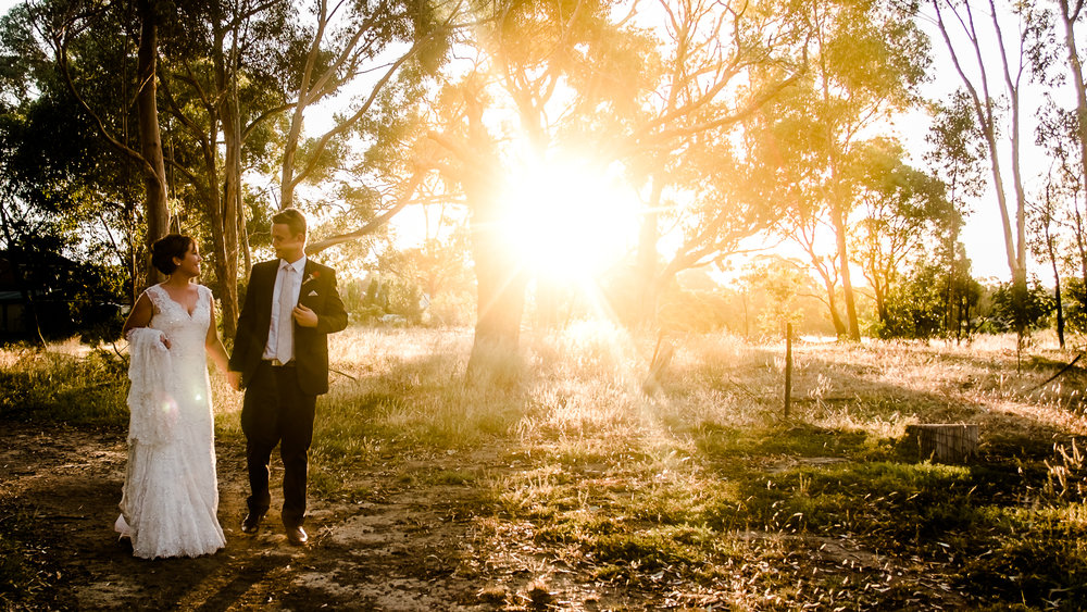 Bride_and_Groom_in_Open_field_at Sunset_melbourne park-taken_by_ClarissePhotography