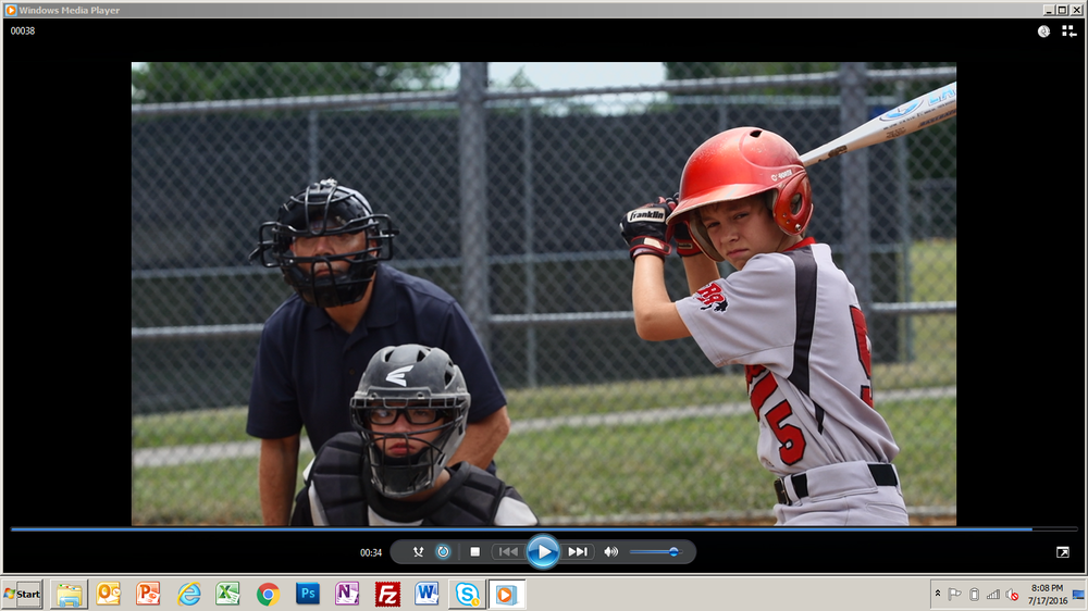 Colin's son at bat.