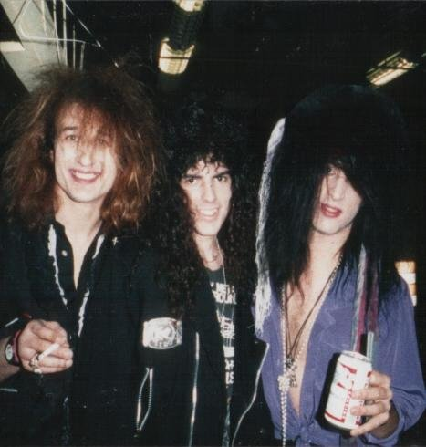 A pic of me with Chip Z'nuff and Derek Frigo. A band I was in got to open a show for them during their tour of their debut album. RIP Derek.