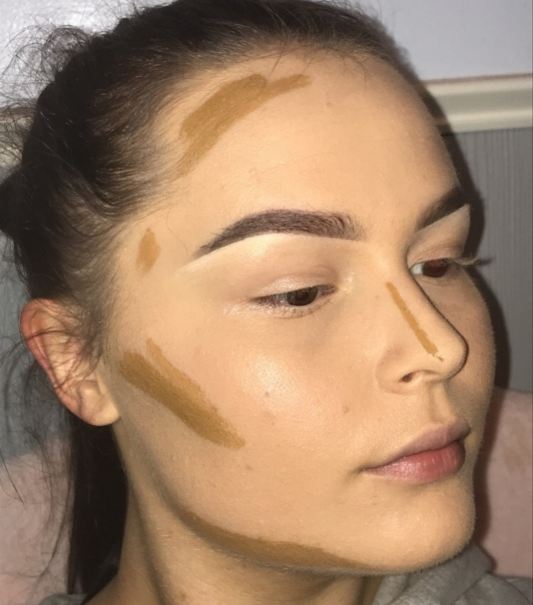Next, we'll add our contour shade. Use a shade that is about 2 or so shades deeper than your natural tone and apply it to the areas that creates shadow, or where you'd like to add more shape/dimension. You can contour all areas of the face, including cheekbones, along the sides of the bridge of the nose, along the jaw, along the hairline and even around the lips.