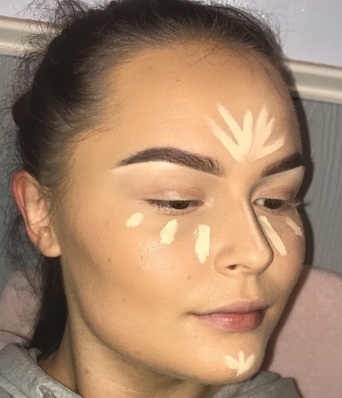 Highlight the center areas of the face with a shade about two shades more fair than your natural skin tone. Highlight can be applied on the under-eye area, bridge of the nose, chin, and forehead.