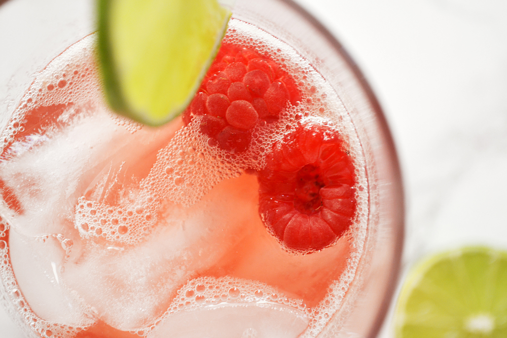 Raspberry Lime Sparkler -- Bubbles, vodka, lime and raspberries.  A refreshing summer drink. | thegirlkyle.com