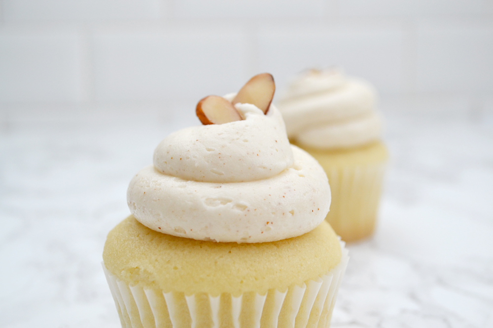 Almond Cupcakes -- Moist almond cupcakes with marzipan frosting. | thegirlkyle.com