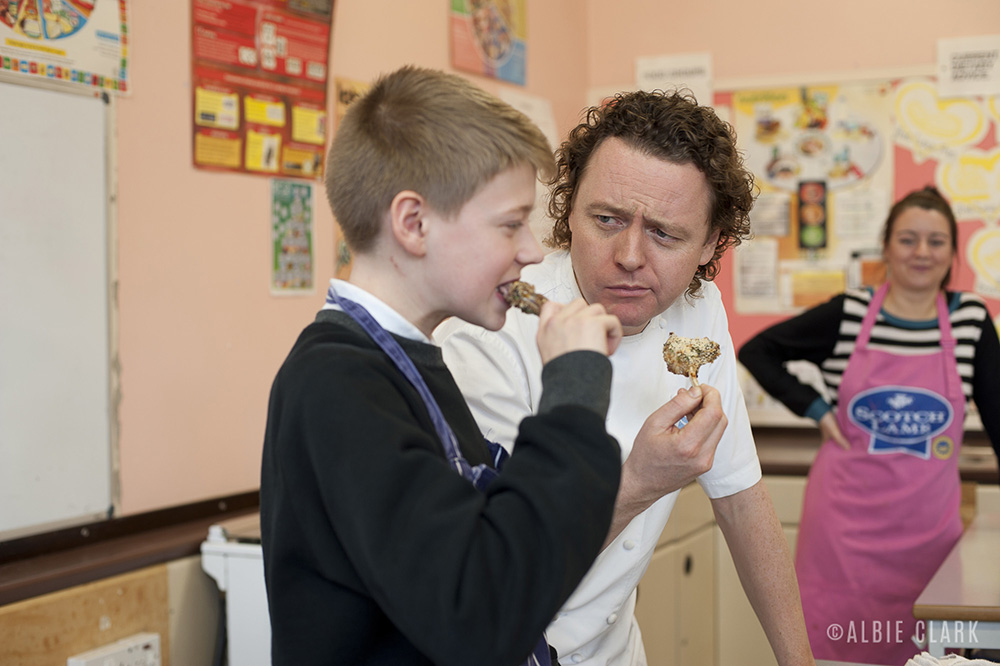 Young Sonny and Tom Kitchin taste the meat out of the oven
