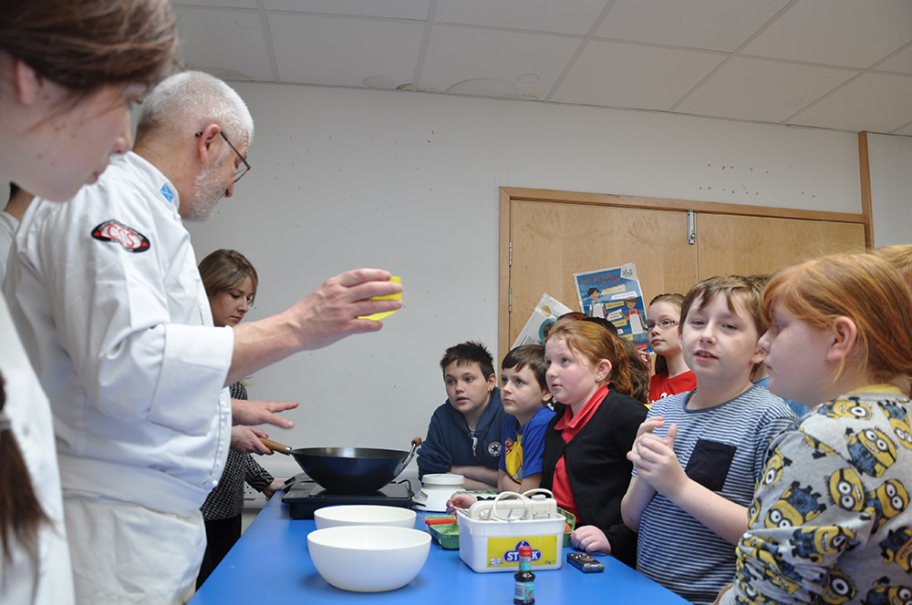 The Budding Chefs and the P6 pupils are making blueberry friands together