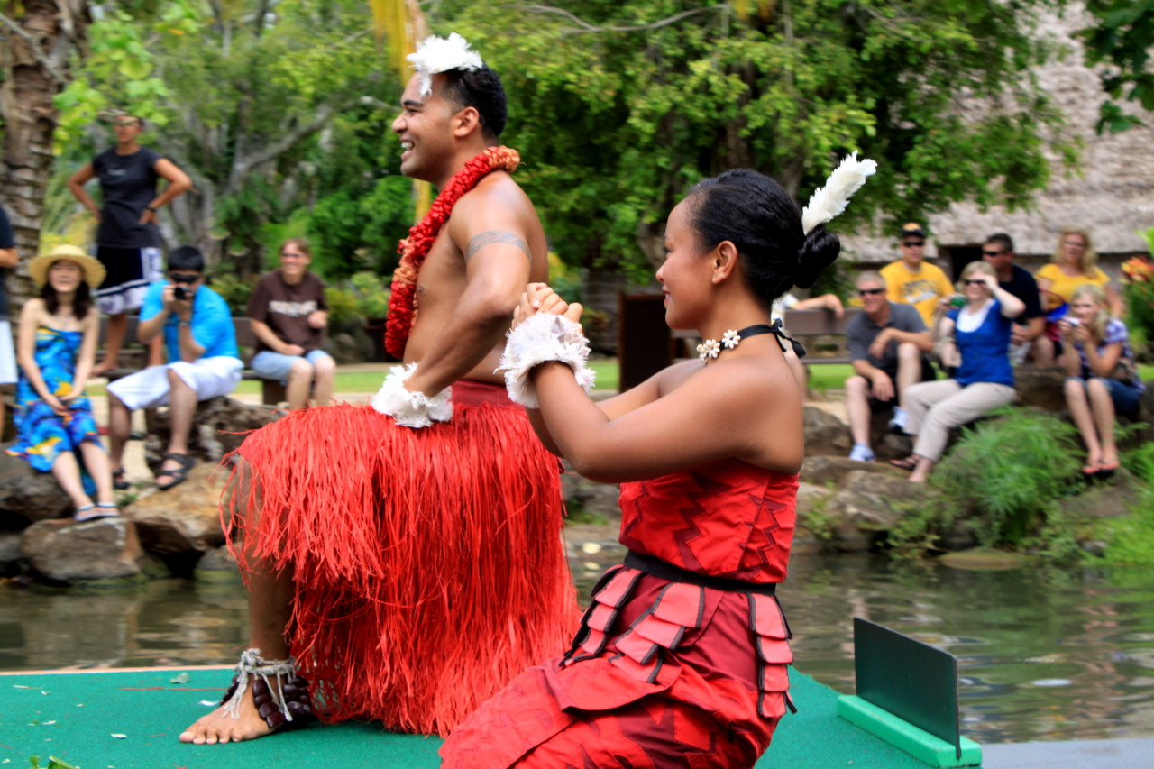 Tongans celebrate at Polynesian boat parade.