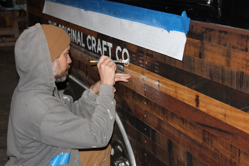 The texture and finish of the reclaimed wood required the steady hand of Wythe Bowart to paint the lettering