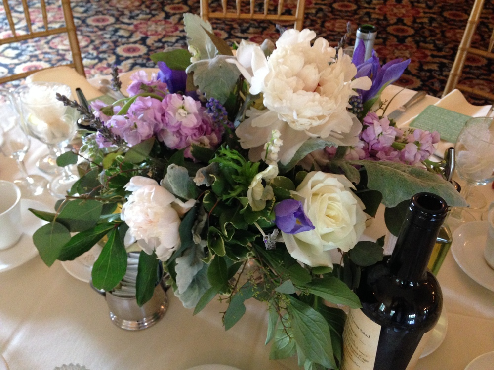 Centerpieces in mercury glass pedestal vases were spectacular to create.