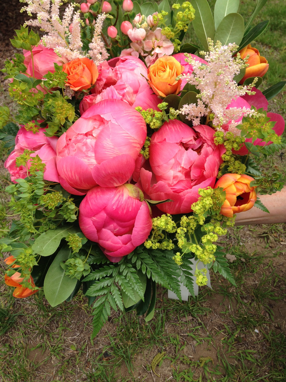 Coral peonies, vibrant tulips, and soft astilbe make a smashing bouquet.