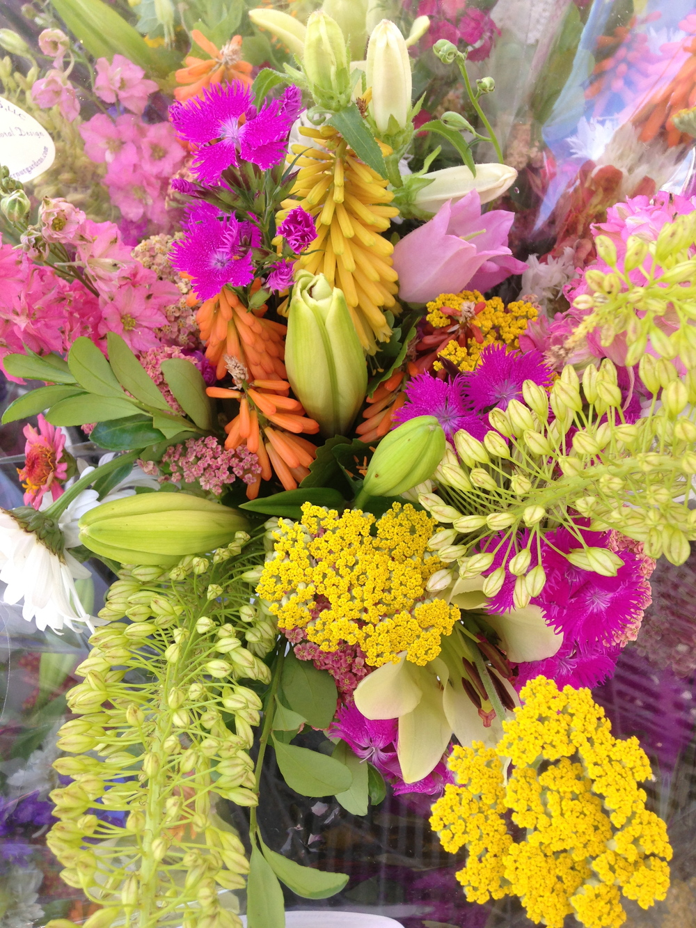 The bright yellow yarrow in lower right puts real zip into any bouquet. Yellow and orange red hot pokers can be seen in the center of this grouping.