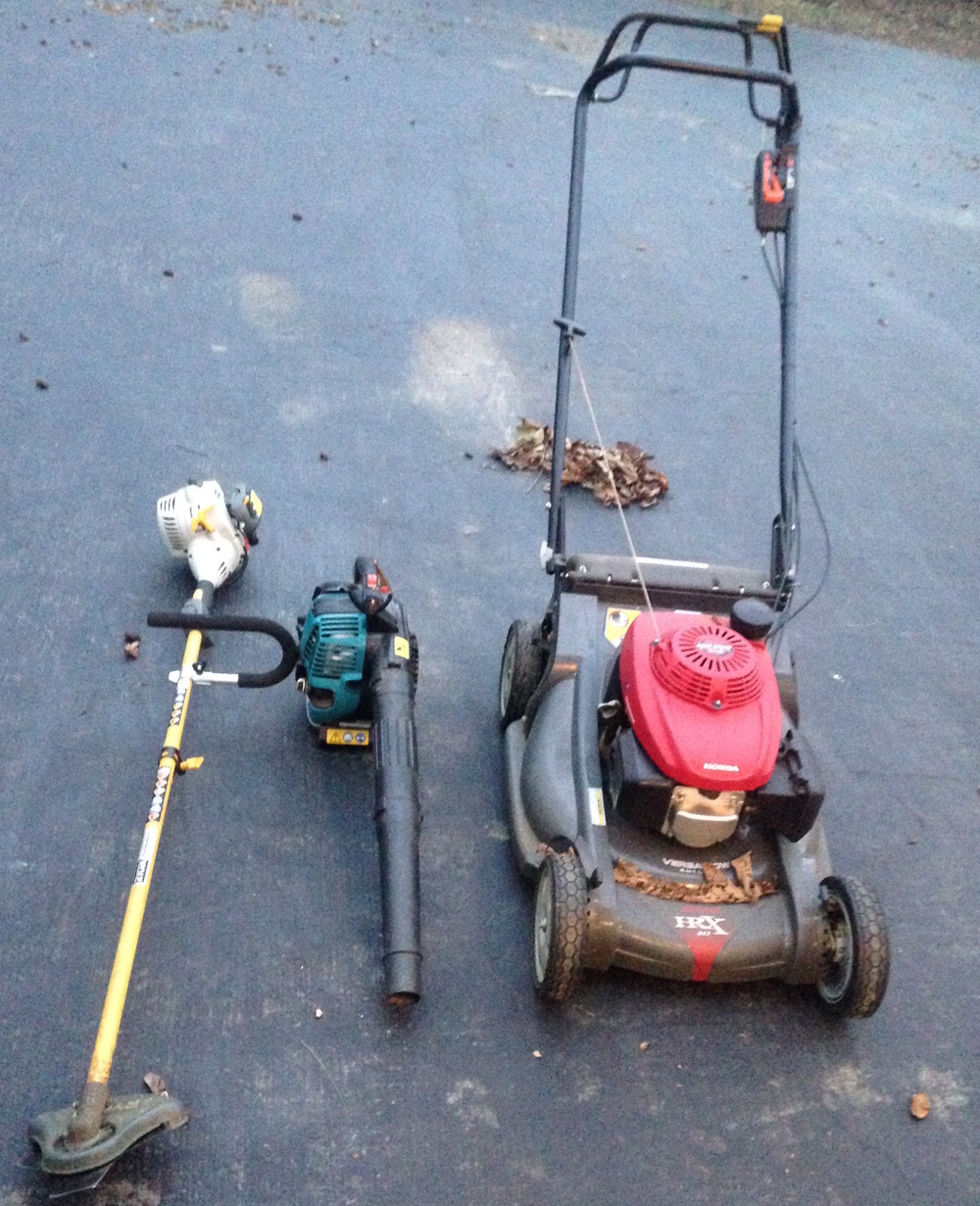 My go-to equipment for keeping my leaves on site: weed whacker, leaf blower, and hand mower.