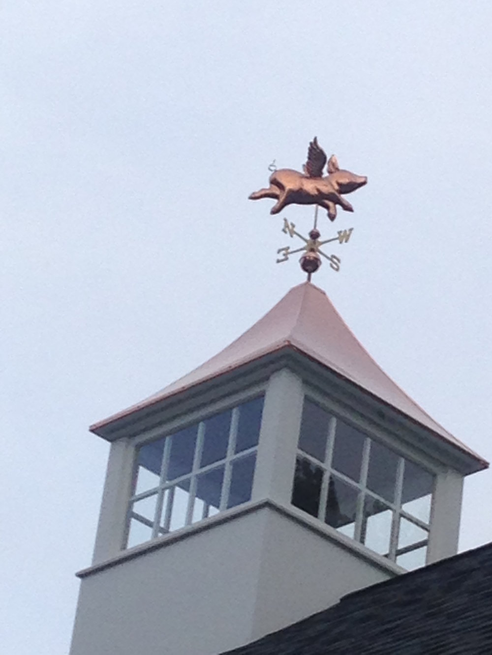 Weathervane on top of the Butternut Gardens LLC barn near the Little White Flower Cottage.
