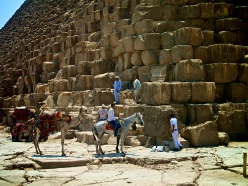 rider next to pyramids